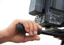 Aged Hand Holding Camera. Aged hand is holding camera for shooting, filming Stock Photo
