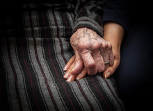 Aged hand holding young hand Stock Photos