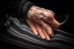 Aged hand holding young hand Royalty Free Stock Photos