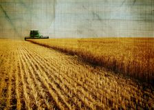 Aged harvest image. Ole aged combine harvest image in a wheat field Stock Photography