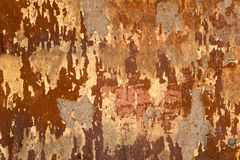 Aged  heavily damaged concrete red wall with patches of gray cement. rough surface texture. A aged  heavily damaged concrete red wall with patches of gray cement stock photo