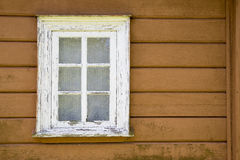 Aged house painted window with ages curtains Royalty Free Stock Image