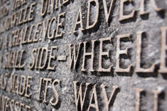 Aged inscription made with metal relief letters Royalty Free Stock Image
