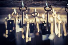 Aged keys for hotel rooms Stock Photo