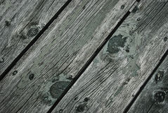Aged knotty wood with worn paint Royalty Free Stock Photo