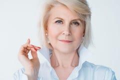 Aged lady confidence elegance stylish index finger. Aged self assured female portrait. Confidence and elegance. Stylish senior lady looking at camera. Index stock photos