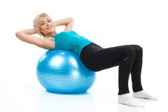 Aged lady lying on fitness ball. Royalty Free Stock Photos