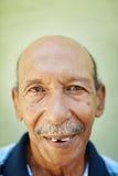 Aged latino man smiling at camera Stock Photo