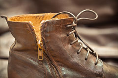 Aged leather boots. Vintage style Royalty Free Stock Photography
