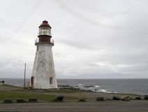 Aged lighthouse. Deserted, unpainted at Port au Choix, New Foundland stock photo