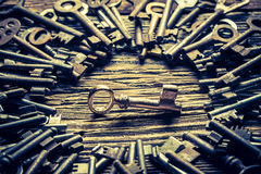 Aged locks nad keys on old wooden table Stock Images