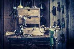 Aged locksmiths workshop with keys and locks Stock Photo