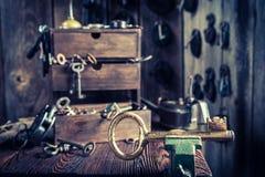 Aged locksmiths workshop with tools, locks and keys Royalty Free Stock Image