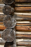 Aged log ends. Straight on view of the end of a log house exterior wall Royalty Free Stock Photography
