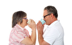 Aged love couple drinking coffee Stock Image