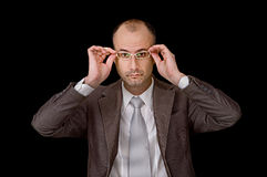 Aged male putting up glasses Stock Photos