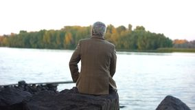 Free Aged Male Sitting On Stone River Bank, Thinking Of Life, Enjoying Nature View Royalty Free Stock Image - 145150606