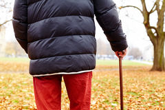 Aged man with cane outdoor Stock Photo