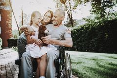 Aged Man with Girl. Girl with Bear on Stroller. Stock Photography