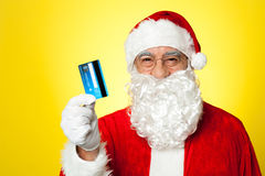 Aged man in Santa clothing ready to shop Stock Photography