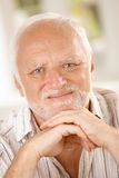 Aged man smiling at camera Stock Photo