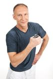 Aged man squeezing gripper and training. Royalty Free Stock Photo