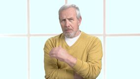 Aged man with terrible pain in his temple. Older man is suffering from migraine, window background. Symptoms of hypertension stock footage