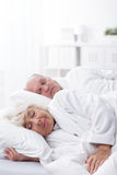 Aged marriage sleeping together Royalty Free Stock Image