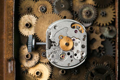 Aged mechanical clock macro view, rusty metal gears background. Shallow depth of field soft focus Royalty Free Stock Photo