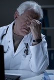 Aged medic having sinus pain Stock Image