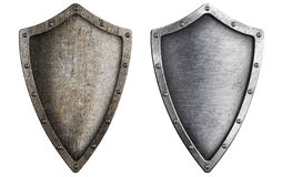 Aged metal shield set isolated. On white Royalty Free Stock Photo
