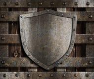 Aged metal shield on wooden medieval gates vector illustration