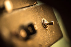 Aged metal toggle. On the old amplifier Stock Photos