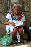 Aged mexican woman. An old Mexican woman is sitting and is working to sell the clothes typical Mexican Stock Image