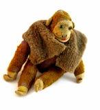 Aged monkey toy. Old damaged and sad monkey toy Royalty Free Stock Photo