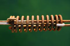 Aged mooring rusted spring on green water Stock Photography
