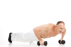 Aged muscular man doing push-ups. Stock Photo