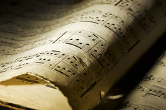 Aged music book. Closeup of yellowed and torn music book Royalty Free Stock Image
