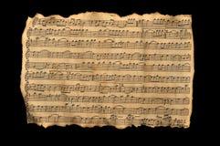 Aged music sheet. Over black background Stock Photo