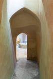 Aged narrow dark vaulted passage Stock Photos