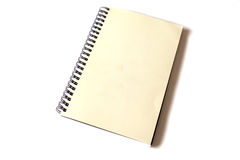 Aged notebook. Aged spiral bound notebook on white background Royalty Free Stock Photos