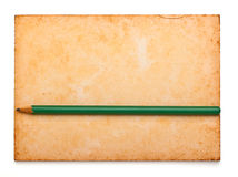 Aged notepad with pencil on isolation Royalty Free Stock Image
