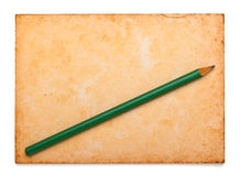 Aged notepad with pencil on isolation Royalty Free Stock Images
