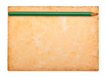 Aged notepad with pencil on isolation Stock Images