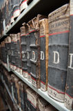 Aged, old books on bookshelf Stock Image