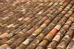Aged old clay arabic roof tiles in rows. As pattern background Royalty Free Stock Photo