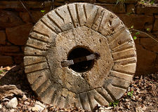 Aged old mill millwheel stone wheel in Spain Royalty Free Stock Photo
