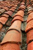 Aged old red clay arabic roof tiles. Traditional architecture roofing in Spain Stock Photo