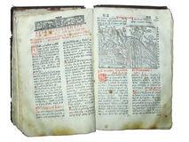 Aged old religious opened book isolated Stock Photos