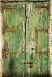 Aged old window blind with worn green paint Royalty Free Stock Photo